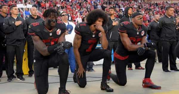 Colin Kaepernick, Eli Harold and Eric Reid take a knee on Oct. 6, 2016. – Photo: USA Today Sports